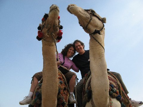 Gail and Dave on a  camel  in the Sahara  Desert