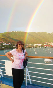 Gail Small and double rainbow in the Caribbean